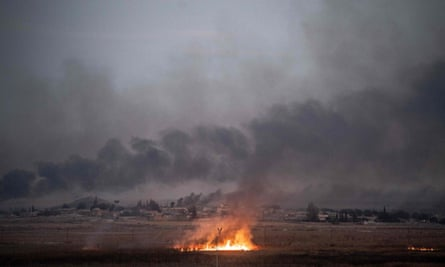 Smoke rises from the Syrian border town of Tel Abyad, following an offensive by pro-Turkish forces.