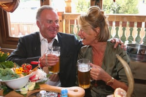 As are Bayern CEO Karl-Heinz Rummenigge and his wife Martina