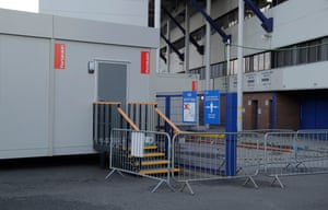 The temporary visitors' locker room, installed in the parking lot behind the Park End booth in Goodison Park.