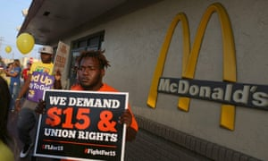 People gather at a McDonald's restaurant in Miami to demand a minimum wage increase to $15 an hour.