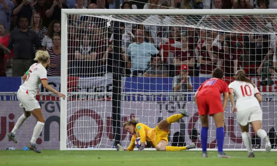 England captain Steph Houghton (left) sees her penalty saved by USA goalkeeper Alyssa Naeher.