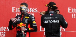 Hamilton gives Verstappen a good soaking on the podium.