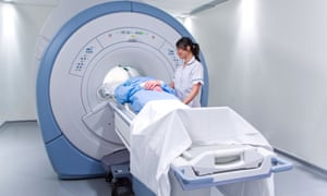Nurse and patient about to enter a scanning machine