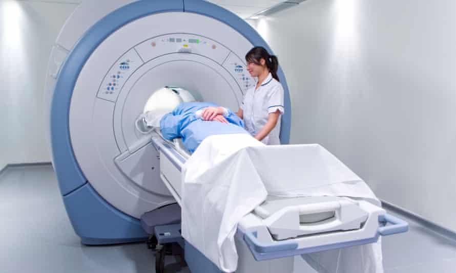 A patient undergoing an MRI scan.