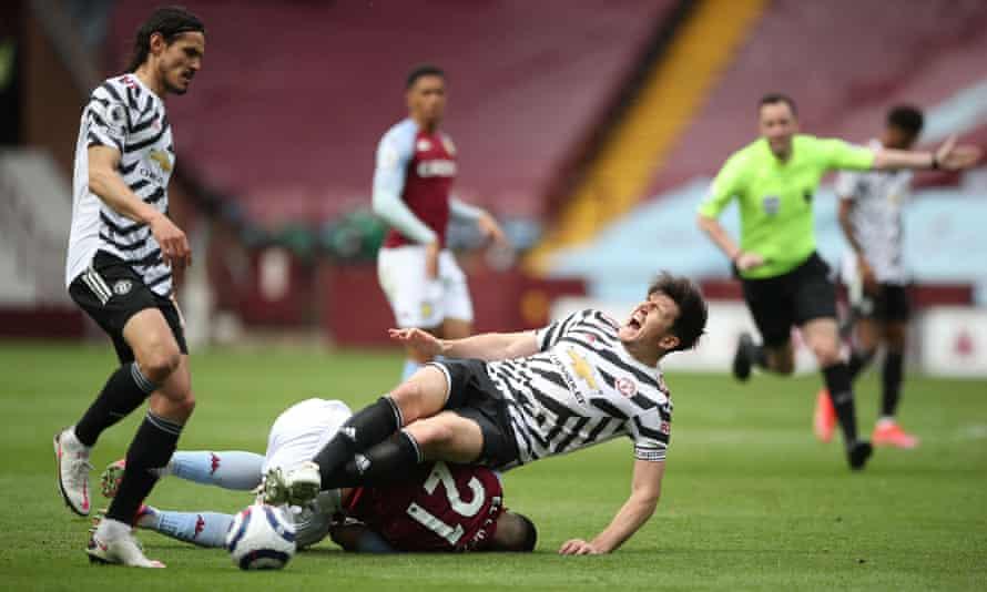Harry Maguire injures himself falling on Aston Villa's Anwar El Ghazi on 9 May