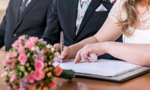 Bride signing the wedding register.
