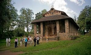 A tour group visits Debre Berhan Selassie Church, Gonder, Ethiopia.