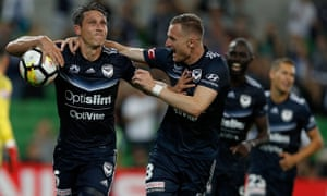 Mark Milligan celebrates with Besart Berisha after scoring a late penalty.