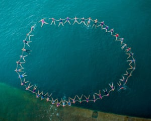 Jersey, UK: 46 swimmers take to the water in Jersey's St Catherine's Bay to celebrate 45 years of the Jersey Long Distance Swimming Club