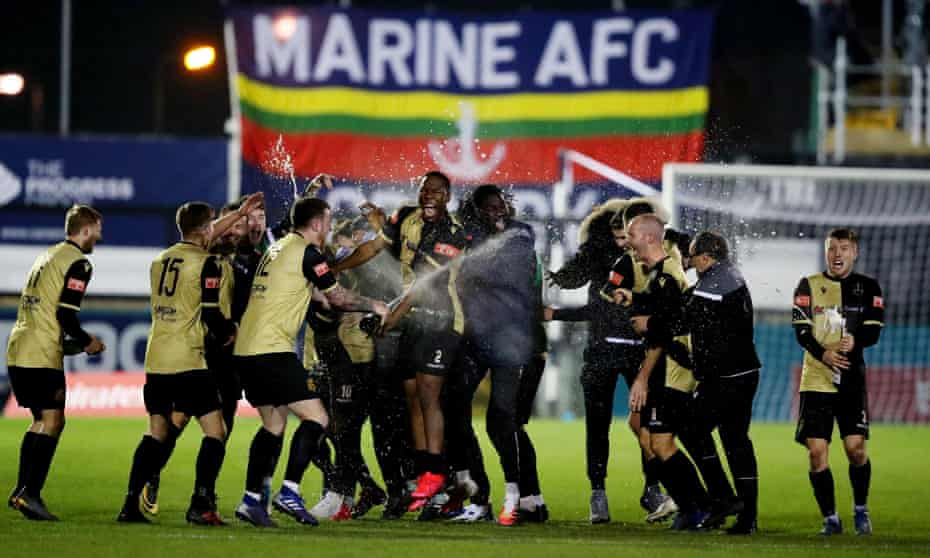 Marine celebrate after beating Havant and Waterlooville to reach the third round for the first time in the club's history.