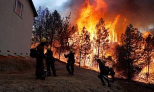 Firefighters monitor a back fire while battling to save homes at the Camp Fire in Paradise, California, in November.