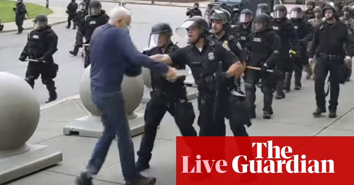 George Floyd protests: Police suspended after pushing 75-year-old protester – live | US news