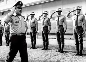 Noriega salutes troops in Panama in 1985