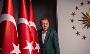 The Turkish president Recep Tayyip Erdogan arrives at a news conference in Istanbul
