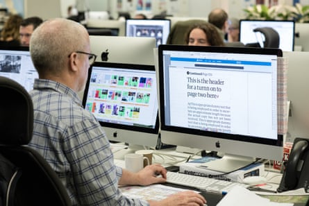 The Guardian newsroom at work on the first edition of the tabloid format