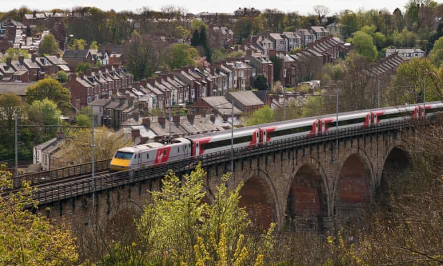 A Virgin east coast mainline train crosses Durham viaduct.