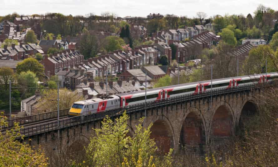 A Virgin Trains East Coast mainline train crossing Durham viaduct in north-east England.