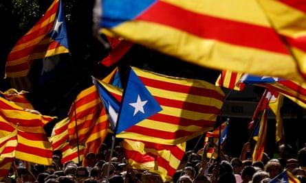 Demonstrators wave the Catalan 'estelada' in Barcelona.