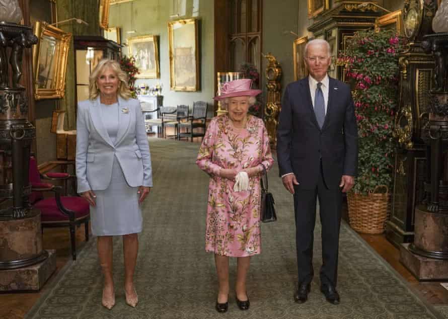 Queen Elizabeth with Joe Biden and Jill Biden in the Grand Corridor at Windsor Castle on Sunday.