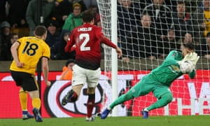 Sergio Romero of Manchester United saves a shot from Diogo Jota of Wolverhampton Wanderers.