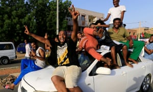 People celebrate in Khartoum after Sudan's military leaders and opposition groups struck a deal.