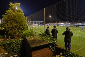 Supporters watch the game from their back gardens.