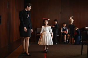 Miona Milakov guides Zoey Zhang on how to walk along a red line on the floor