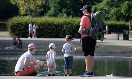 A family relaxes by a pond in Regent's Park, London, in August.