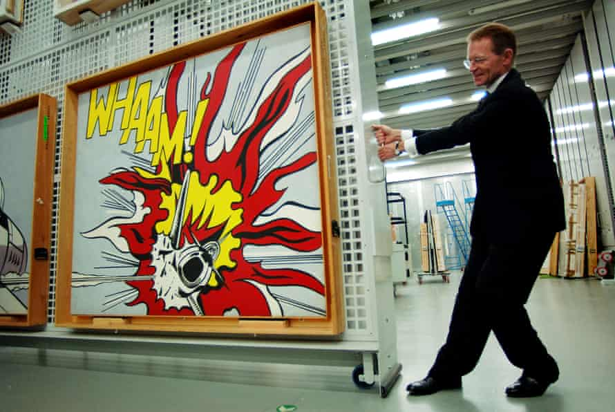 Nicholas Serota wheels Roy Lichtenstein's painting entitled Whaam! out of storage for a Tate Modern' rehang in 2006.