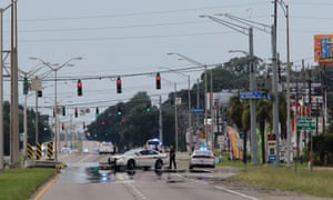 Baton Rouge police block off the roads near where three officers were shot dead on Sunday.
