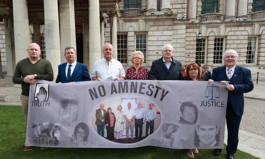 Eugene Reavey (far right), whose brothers were shot in their home by the Glenanne gang, protesting against UK plans for an amnesty for Troubles-related prosecutions.