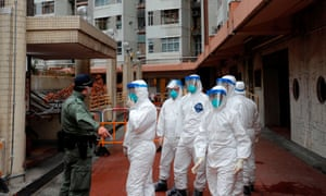 Police in protective gear prepare to evacuate residents from a public housing building following the coronavirus outbreak in Hong Kong.