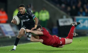 Keelan Giles is tackled by Ken Owens during Ospreys' Pro12 match against Scarlets.