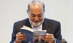 Carlos Slim looks at Donald Trump's book Great Again.