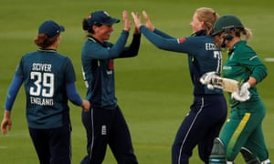 England's Georgia Elwiss, centre, celebrates with Sophie Ecclestone after catching out South Africa's Dane van Niekerk.