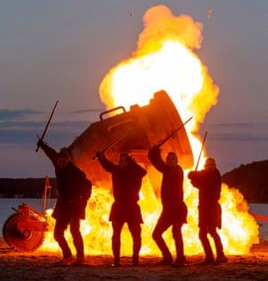 Stuntmen rehearse a fight scene in front of a fireball at Störtebeker festival in Rügen Island, Germany