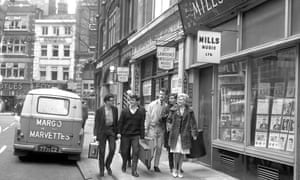 A pop group arrives for a recording session in Denmark Street, known as London's 'Tin Pan Alley,' 1964.
