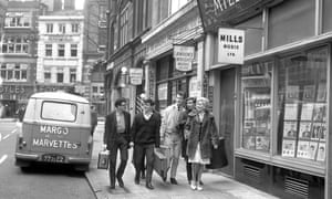 A pop group arrives for a recording session in Denmark Street, back when it was known as London's Tin Pan Alley