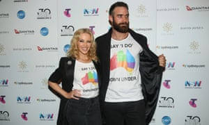 Kylie Minogue and per partner Joshua Sasse make a surprise appearance at the 30th annual Aria awards at the Star in Sydney on Wednesday evening in pro marriage equality T-shirts.