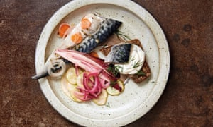 Mackerel on a plate with slices of rye bread and fennel