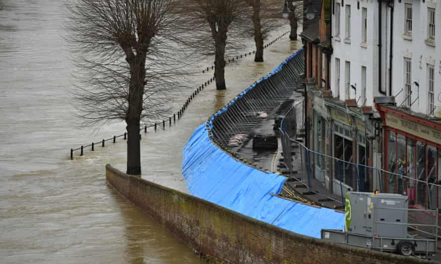 Temporary flood barriers hold back the river Severn in Ironbridge, Shropshire