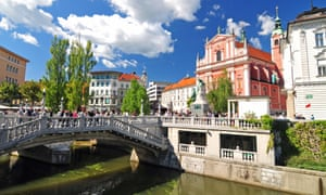 Ljubljana, Slovenia, Triple bridges and St. Francis church in the background on a brigh sunny day