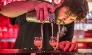 A bartender mixes a couple of pipe dream micrococktails at Meatliquor