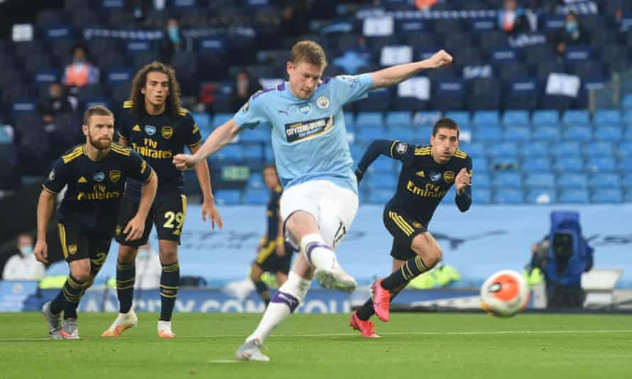 Kevin De Bruyne slots home Manchester City's second goal from the penalty spot in their 3-0 win over Arsenal.
