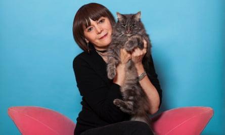 Britt Collins holding a cat