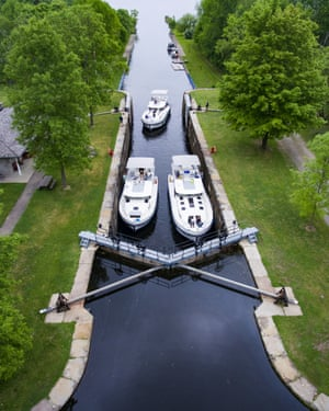 Aerial of three Le Boat Horizon houseboats in lock at Beveridge Locks, near Lower Rideau Lake, Ontario, Canada