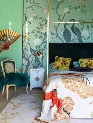 A taste of the east: chinoiserie on the walls and textiles in the bedroom.