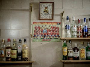 A picture of Spain's national football team hangs on a wall at the bar in the village of Anquela del Ducado.