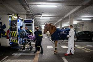 Peyo and Bouchakour accompany Roger to the ambulance that will take him home after his treatment
