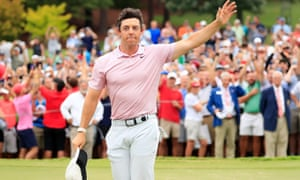 Rory McIlroy salutes the crowd on the 18th green
